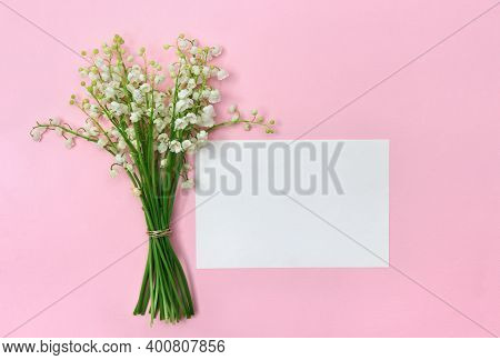 White Flowers Lily Of The Valley ( Convallaria Majalis, May Bells, May Lily ) On A Pink Paper Backgr