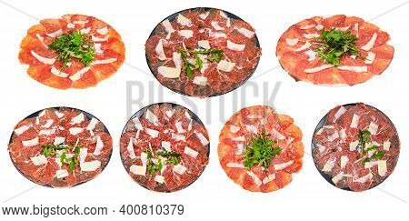 Collection Of Served Served Carpaccio (thinly Sliced Raw Beef Fillet) Dishes On Plate Isolated On Wh
