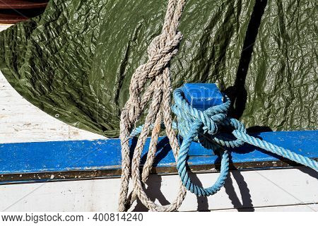 Cleat With Blue And White Rope. Small Blue Cleat With Blue And White Rope For Ships And Boats. Blue