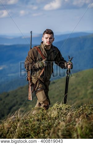 Hunter Man. Hunting Period. Male With A Gun. Close Up. Hunter With Hunting Gun And Hunting Form To H