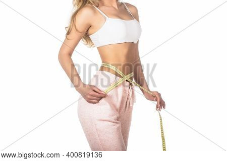 Slim Girl With Centimeter. Closeup Woman Measuring Her Waist With Tape. Slim Womans Body