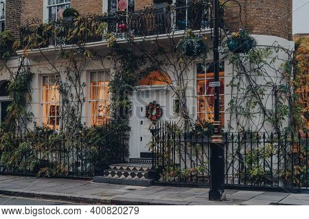 London, Uk - December 5, 2020: Christmas Wreath On The Door Of Greenery Covered House In Mayfair, An