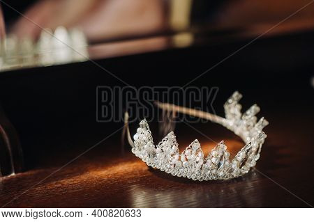The Wedding Crown For The Bride Is On The Table