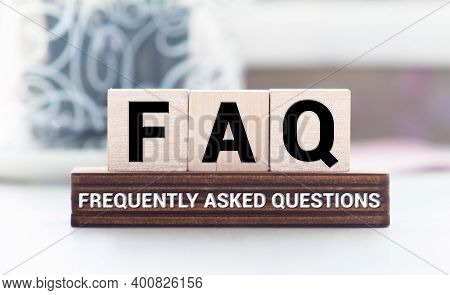 Faq Word On Wooden Block On Top Of Wooden Background
