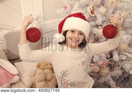 Go Glam This Xmas Season. Happy Child Hold Xmas Tree Balls. Little Girl Celebrate Xmas And New Year.