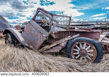 Abandoned Vintage Truck With Wooden Spokes On The Prairies In Saskatchewan
