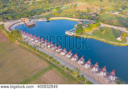Aerial View Of Home, House Or Resort Under Contruction With Lake Or River With Reflection. Green Mou