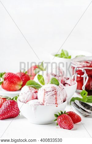 Strawberry Ice Cream With Topping, Decorated With Mint Leaves, White Background, High Key, Selective