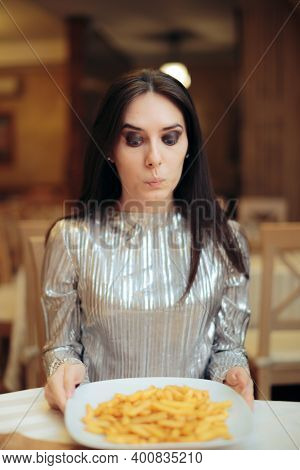 Craving Woman Looking At A Plate Of French Fries
