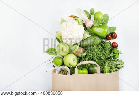 Healthy Green Vegan Vegetarian Food In Full Paper Bag, Vegetables And Fruits On White Background. Sh