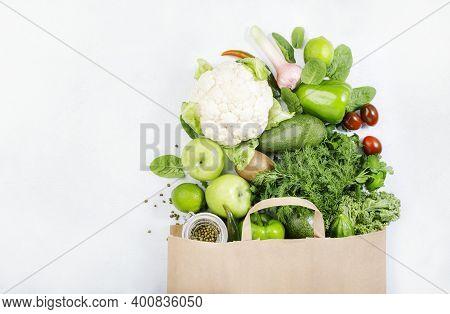 Healthy Green Vegan Vegetarian Food In Full Paper Bag, Vegetables And Fruits On White Background. Sh