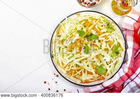 White Cabbage Salad Coleslaw With Carrot On White Kitchen Table Background. Top View, Copy Space