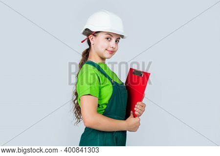 Safety Expert. Kid Wear Helmet On Construction Site. Teen Girl Builder With Building Paper Document.