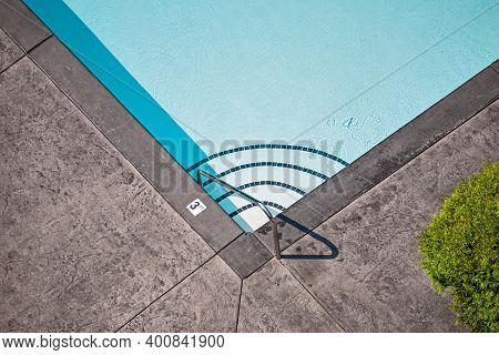 Corner Of Emerald Swimming Pool With Steps Leading To The Deeper Water