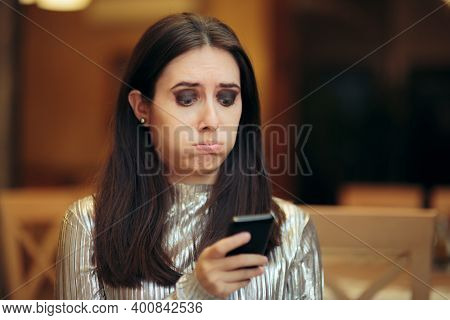 Sad Woman Reacting To A Rude Text Message