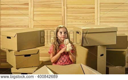Packaging Things. Only True Friend. Girl Child Play With Toy Near Boxes. Move Out Concept. Stressful