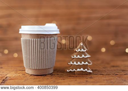 Christmas Tree And Coffee Takeout. Cup Of Tea And Gingerbread Cookies At Wooden Background. Homemade