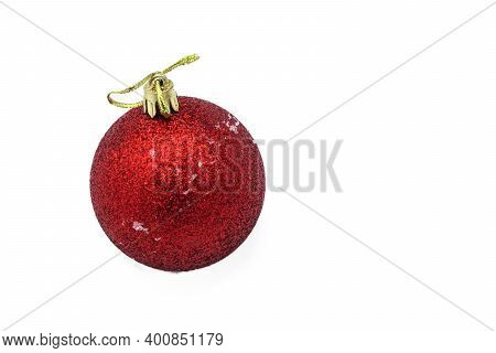 Christmas Red Ball Lying On An Isolated White Background.