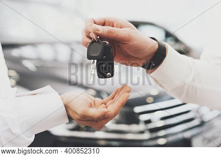 Close Up. Arabic Man At Car Dealership. Salesman Is Giving Keys For New Car To Man And His Wife.