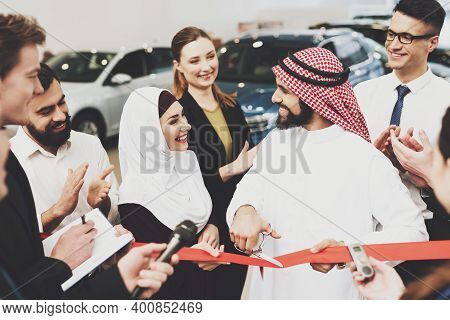 Man Is Opening New Dealership With His Wife. Arab Man Makes The Opening Of A New Car Dealership With