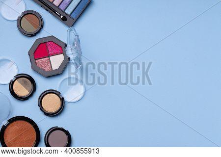 Set Of Eyeshadows On Blue Background Close Up