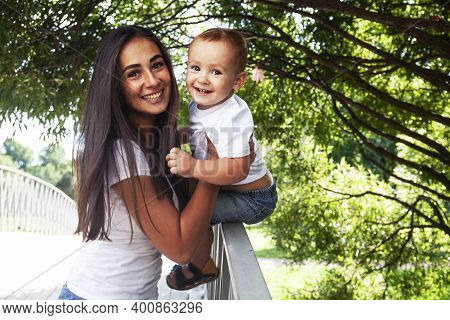 Young Pretty Brunette Mother With Little Cute Boy Walking In Park Happy Smiling, Lifestyle People Co