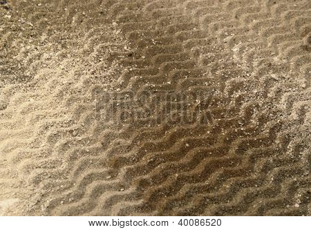 Wavy Lines On Brown Sand Surface