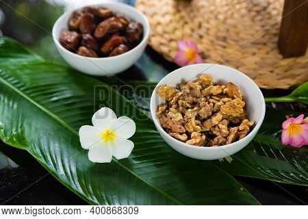 Walnuts And Dates Decorated With Tropical Frangipani Flowers In Koh Samui Thailand, Vegan And Vegeta