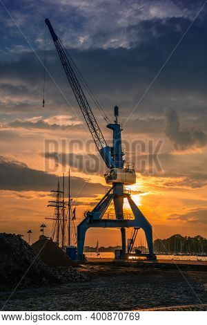 Cran In The Harbour Of The Hansa Stadt Rostock, Germany.