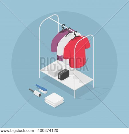 Vector Isometric Clothes Rack Illustration. T-shirts On Hangers With Shoe Box, Bag, Brush And Sticky