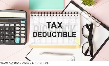 Text Sign Showing Tax Deductions. Conceptual Photo Reduction On Taxes Investment Savings Money Retur