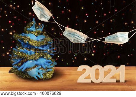 New Year's Card 2021. Christmas Tree Made Of Blue Medical Gloves Against The Background Of A Garland