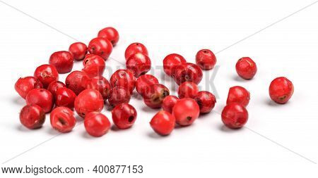 Red Or Pink Peppercorn Scattered On Board, Closeup Photo Isolated With White Background