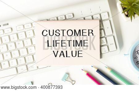 Customer Lifetime Value - Handwritten Text In A Notebook On A Desk