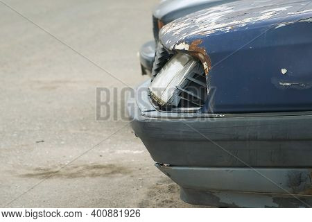 Closeup Of Broken Car Headlight After An Accident, Side View. Totally Wracked Car After Accident. Bo
