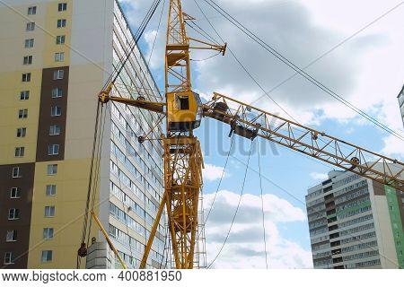 Tower Crane On A Construction Site For Lift A Load At High-rise Building. Construction Of Residentia