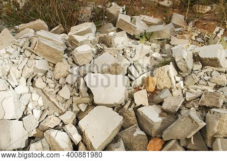 Construction Debris On Site With Broken Panels And Bricks, Closeup View. Construction Dump With Garb