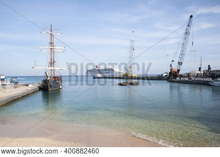 The View Of Different Ships And Port Cranes In George Town On Grand Cayman Island (cayman Islands).