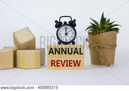 Annual Review Symbol. Concept Words 'annual Review' On Wooden Blocks On A Beautiful White Background