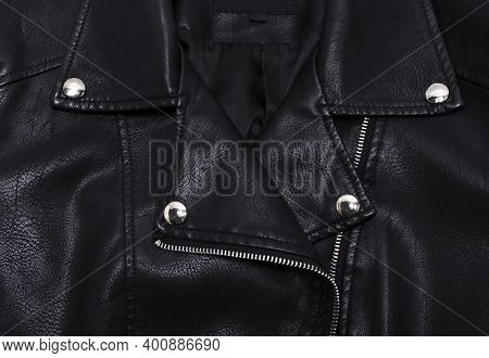 Zipper And Rivets On A Black Leather Jacket. Close Up Of A Black Jacket