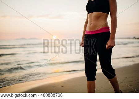 Runner Woman Jogging On Beach In A Sports Bra Top.fit Fitness Woman Training And Working Out Outside