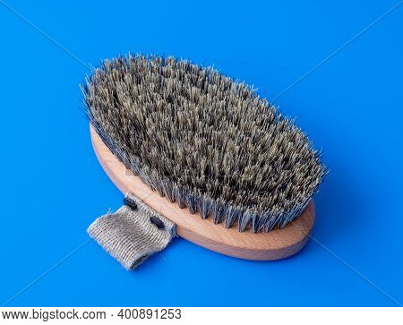 Massage Brush With Natural Boar Bristles On A Blue Background