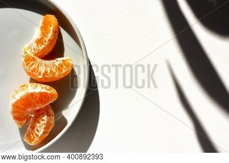 Tangerines Or Oranges, Clementines, Citrus Fruits On White Background With Shadows.selective Focus.r