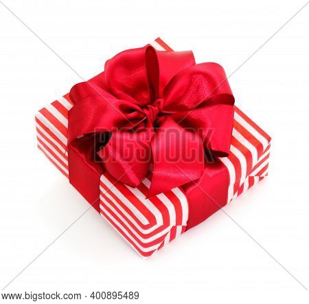 Red Gift Box With Red Ribbon Isolated On White Color Background.