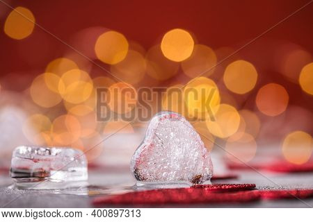 Ice Hearts On A Gray Background. Love Concept. Romantic Card With Frozen White Heart.