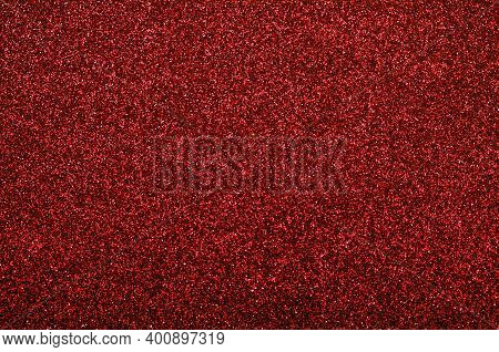 Shiny  Bright Holiday Abstract Red Glitter Texture Background With A Beige Stripe.