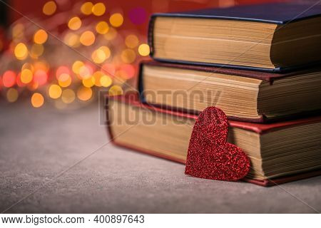 Stack Of Books And Red Heart. Romantic Background With The Book. Valentines Day Postcard. Love Conce