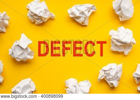 Defect Text On Yellow Background With Copy Space. Crumpled Sheets Of Paper Lie Around. Business Conc