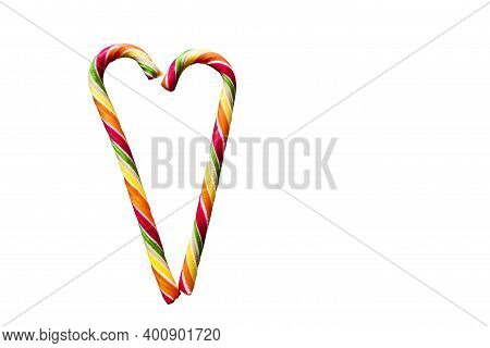 Multicolored Striped Heart-shaped Lollipops On A White Background. Christmas, New Year, Valentine\'s