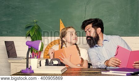 Following Example. Girl Pupil Study With Bearded Teacher. Studying Methods For Children. School Educ